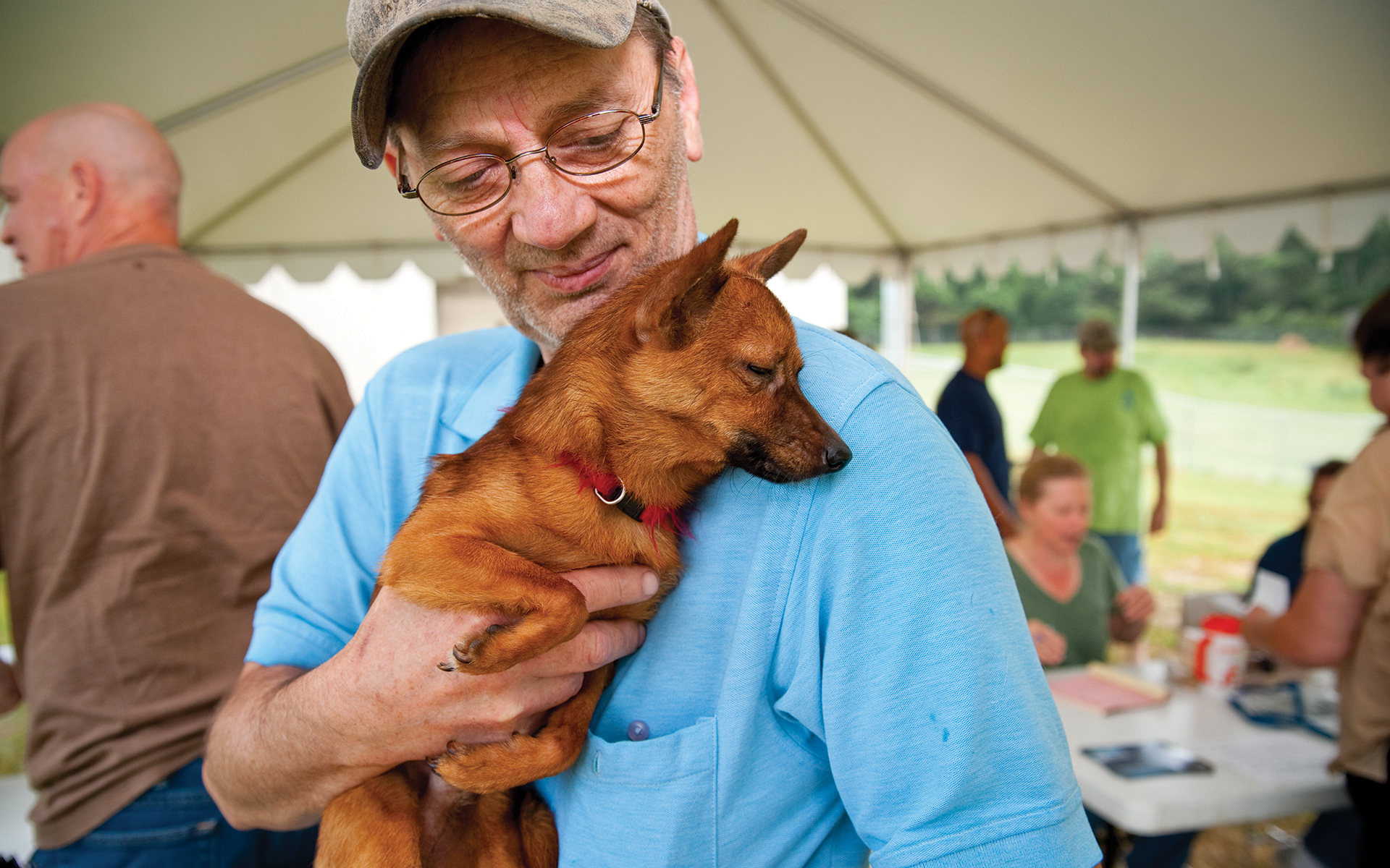 Inclusion = Lifesaving: man with dog